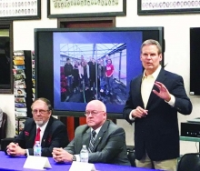 Governor Bill Lee (standing) delivers remarks at the round table discussion held during his visit to Alvin C. York Institute on Friday, February 15, 2019. Also pictured are Jamestown Mayor Lyndon Baines (left) and Fentress County Executive Jimmy Johnson (center).